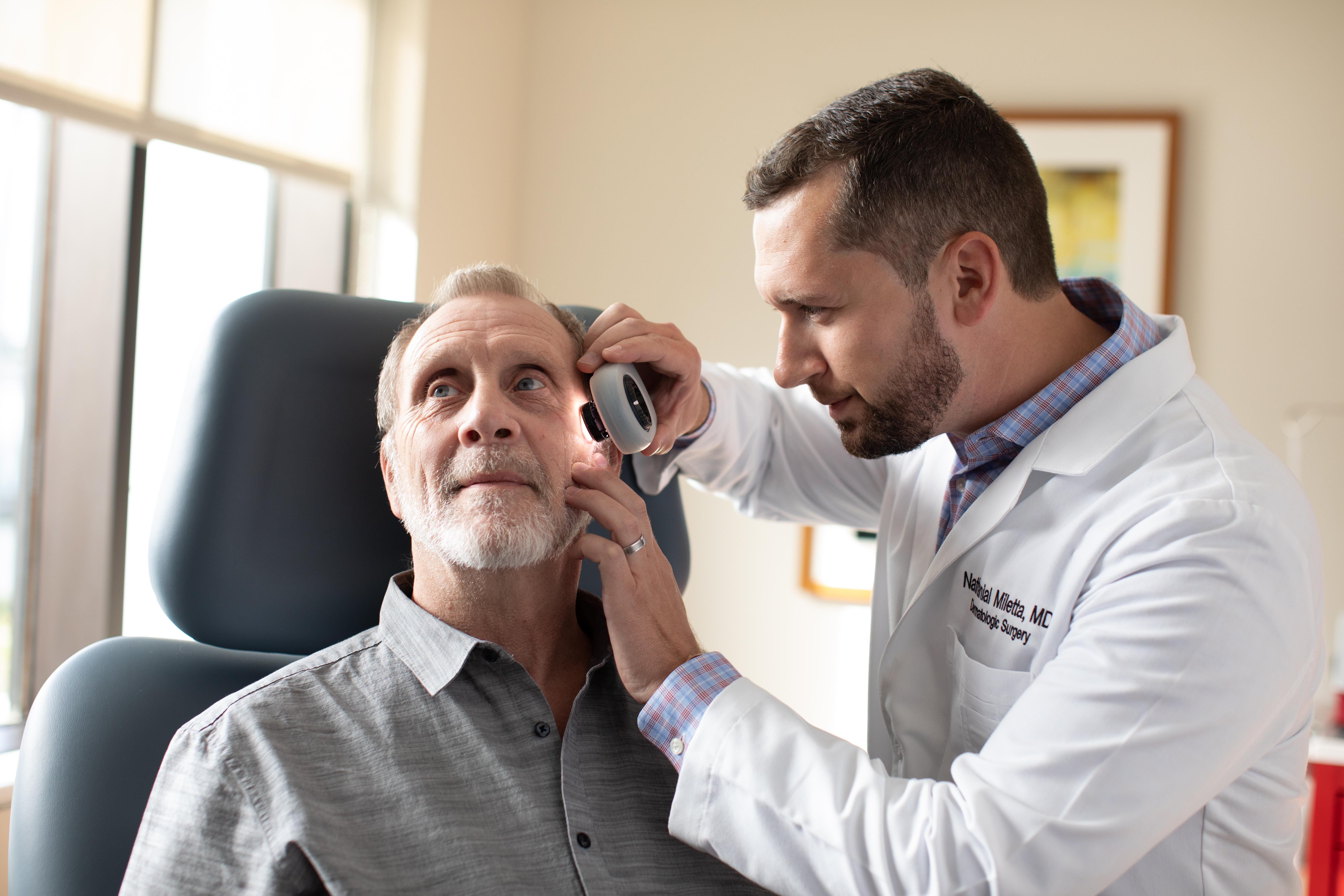 patient with dermatologist